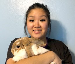 Team member Alicia holding her bunny